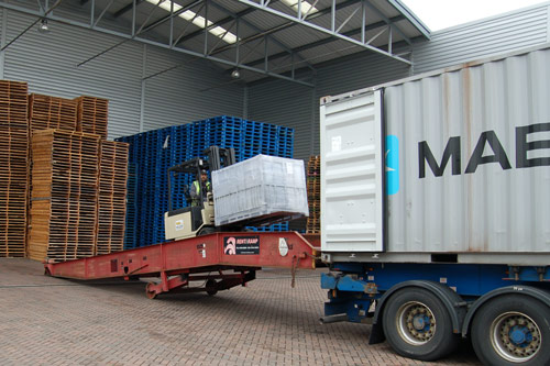 Man Unloading a Shipping Container