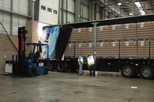 Unloading a truck in Glasswells Warehouse